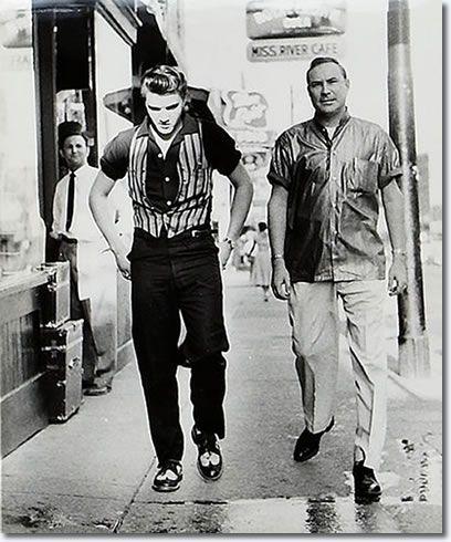 Elvis Presley and Dewey Phillips (greatest rock n roll radio programmer) walking in Memphis