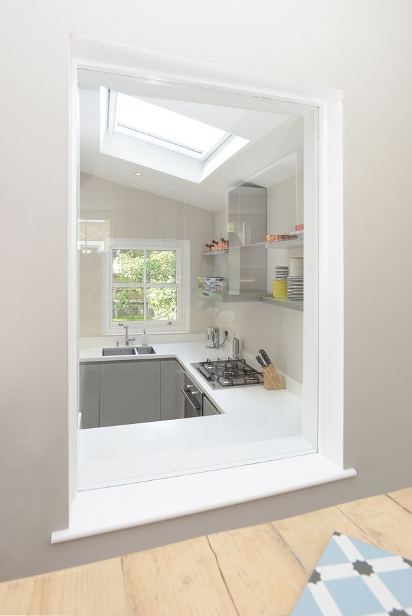 Side Return Extension on a Victorian Terraced House in Battersea, SW6, London, Flat Roof with Skylights, Open Plan Design, White Kitchen, Bright Open Plan Living, Internal Window, Pendant lights, Small Kitchen Ideas, Contemporary Kitchen Extension,