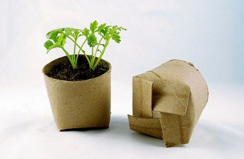 If you're starting plants from seeds this year, don't waste your hard-earned cash on tiny planters from the garden center. Save a few bucks - and get a little more use out of your throw-aways - by making your own seed-starters from recycled materials!  To make your own biodegradable mini-planter (that's right, no transplanting!), you will need scissors and a toilet paper or paper towel roll