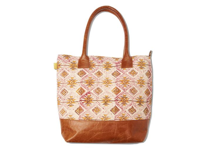 If you like classic looks, then you'll love the Tribal Leather Handbag. Sturdy and convenient for everyday use, the classy leather matched with a vibrant block-print fabric is a great compliment to any style.