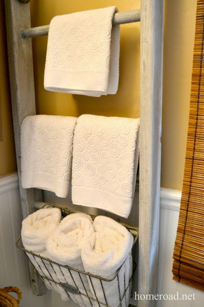 s 11 space saving hacks for your tiny bathroom, bathroom ideas, Hang a ladder on your wall for towels