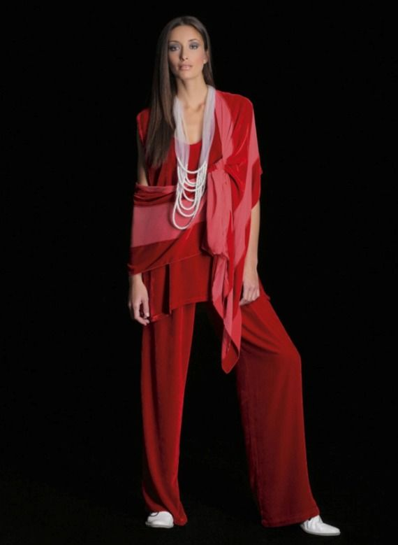Loose red jumpsuit, paired with white shoes and striped red scarf by Join Clothes