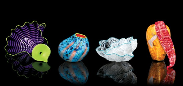 Every year, Chihuly Workshop collaborates with Dale Chihuly to create four Studio Editions. Each piece is drawn from one of the distinctive series of works he's created throughout his career.  Vibrant and dynamic, the Studio Editions are offered through museums, galleries, and other organizations across the country and abroad as well as at the Workshop. All Editions are handblown, signed by the artist, and accompanied by a Plexiglas vitrine and black base for display.