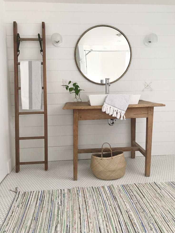 Vintage modern bathroom. Farmhouse vanity, shiplap walls, vessel sink, vintage ladder, rag rug, hex tiles, white on white, Jennifer Simon Design