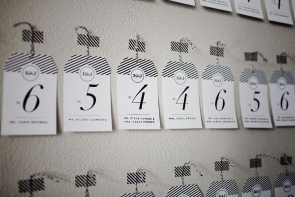 black and white stripes look awesome on these modern seating cards  Photography by http://turnercreative.net