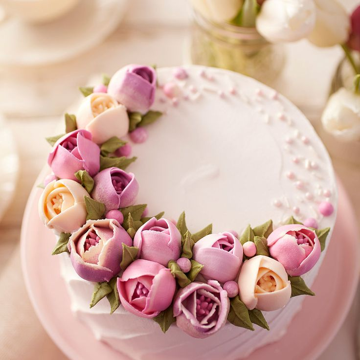 Surprise the mom in your life with this stunning Tulip Cake. Beautiful buttercream tulips make this cake perfect for spring, and there is even room on the cake to personalize it, if so desired. Show Mom how much she means to you by making her this beautiful handmade cake!