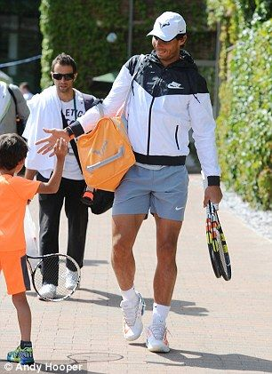 Nadal gives a young fan a high-five ahead of Wimbledon...Nadal is 10th seed.