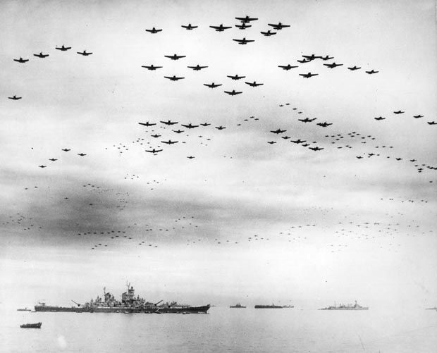 Fighter planes fly in formation over the USS Missouri, while the surrender ceremonies to end World War II take place aboard the U.S. Navy battleship, on September 2, 1945.
