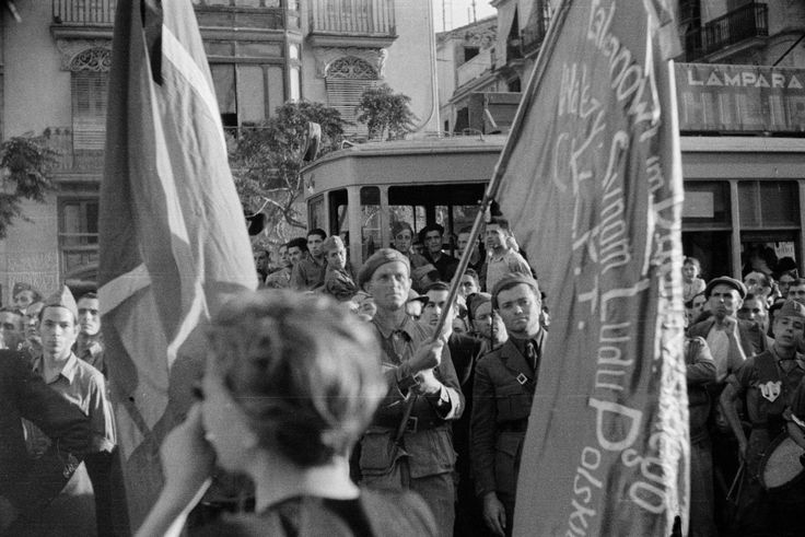 Gerda Taro is photographed from behind on June 12, 1937 as she snaps the Dabrowski battalion during a tribute in Valencia to Hungarian General Lukacs (Máté Zala), who had died a few days earlier at the Huesca front during the Spanish Civil War. The moment was captured by Emilio Rosenstein, a Jewish Pole who fled to Paris in 1928 to escape the anti-Semitism of universities back home and study abroad.