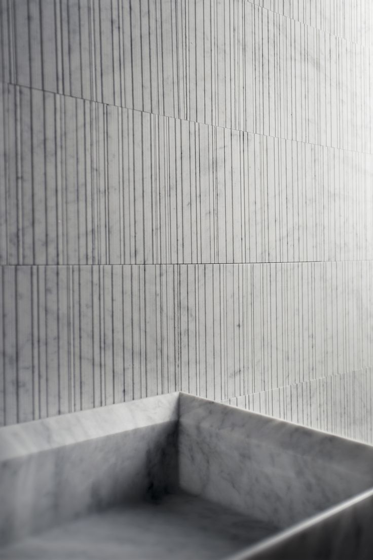Designed by Piero Lissoni, Raw represents the ruggedness of hewn wood, translated in stone to create a nuanced play of light and shadow. Raw can be installed both vertically and horizontally. Available in Bianco Carrara, Crema d'Orcia, Pietra d'Avola and Silk Georgette®.