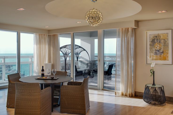 ART Rotana Classic Suite Living Area and View of Terrace