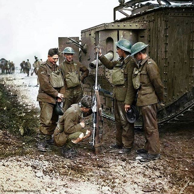 Canadian soldier check out a Mauser next to a British tank
