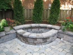 backyard burn pit - I like that it's built into a wall/landscape instead of a random circle in the yard