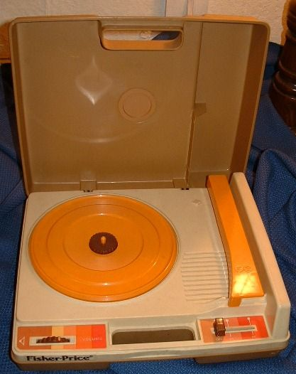 Fisher Price record player, before we had a TV set, we listened to stories and songs on one of these....wish I still had all our story albums, Uncle Remus and king Midas were my favorites