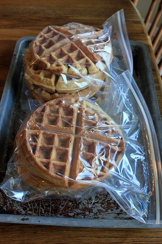 Homemade Freezer-Friendly Waffles    Makes 6 Belgian waffles        1 3/4 cups flour (whole-wheat, white, or a mixture of both)      2 Tablespoons sugar (or raw sugar)      1 Tablespoon baking powder      2 eggs      1 3/4 cup milk (You can use half milk/half water, if you prefer.)      1/2 cup oil or melted butter      1 teaspoon vanilla