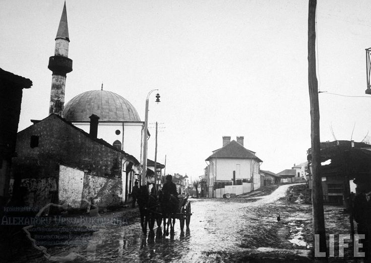 78.Turtucaia.Mosque on muddy street in main part of town.