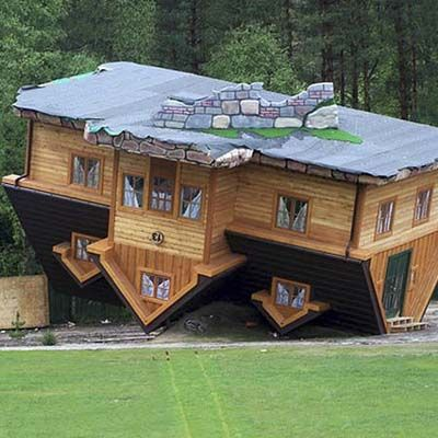 "WRONG DOINGS AGAINST HUMANITY - The Upside-Down House, Szymbark, Poland.    This structure was built by Polish philanthropist and designer Daniel Czapiewski to serve as a constant reminder of ""wrong-doings against humanity"" and the backwardness of the world. Poland's former Communist rule inspired the project, as Czapiewski thought all decisions being made at the time were detached from reality."