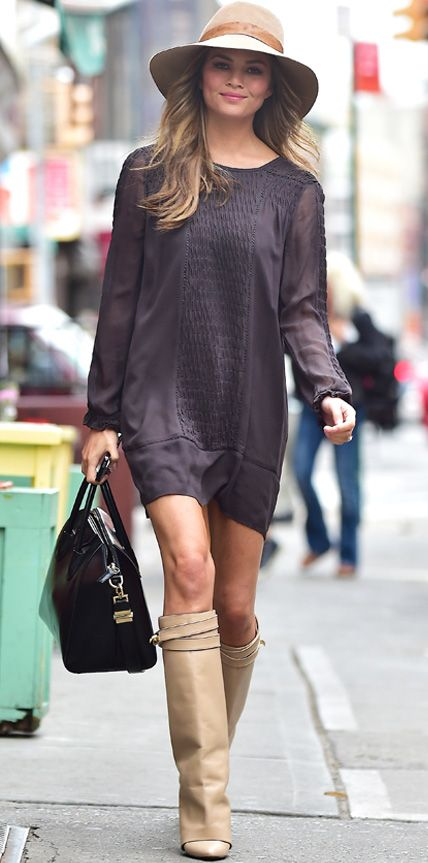 Chrissy Teigen has definitely figured out in-between weather dressing—she styled her long-sleeve aubergine shift with a floppy wool hat, a black carryall, and tan knee-high boots.
