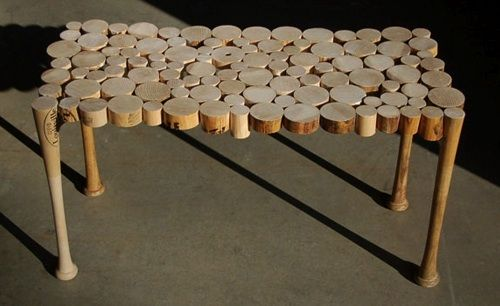 a table made from recycled baseball bats - great DIY furniture idea! Follow link for 10+ ideas for recycling your old sports equipment