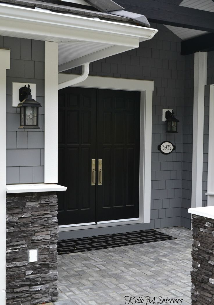 exterior of home with chelsea gray painted shakes, black painted double front door and white trim with dark charcoal ledgestone