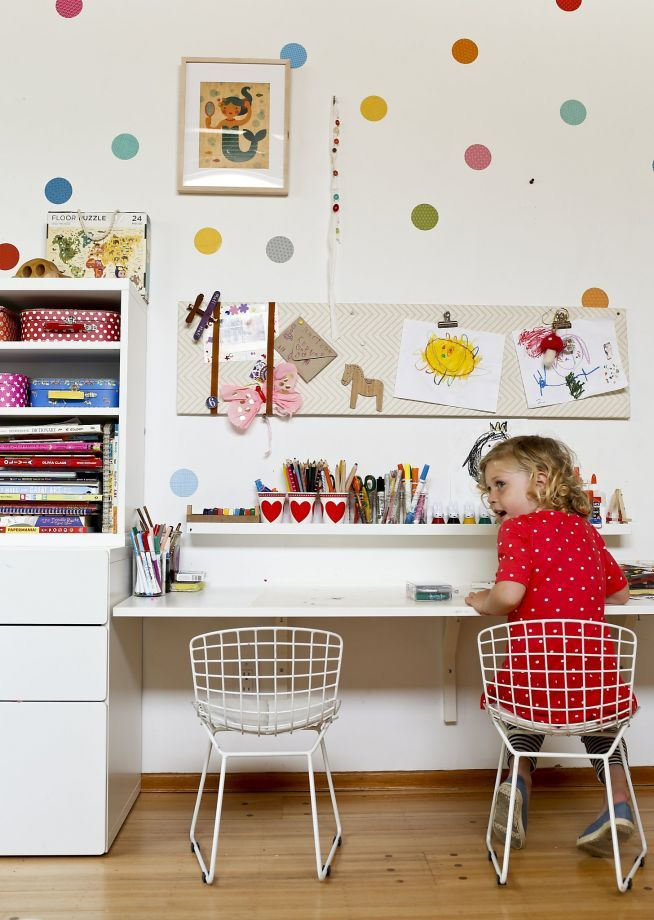 Matilda Kerner, 5, daughter of designer Lorena Siminovich, works on her own craft projects in her playroom. Photo: Russell Yip, The Chronicle