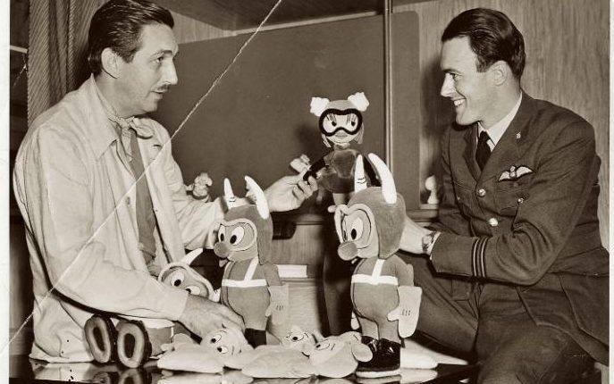 Dahl and Walt Disney with toys inspired by The Gremlins