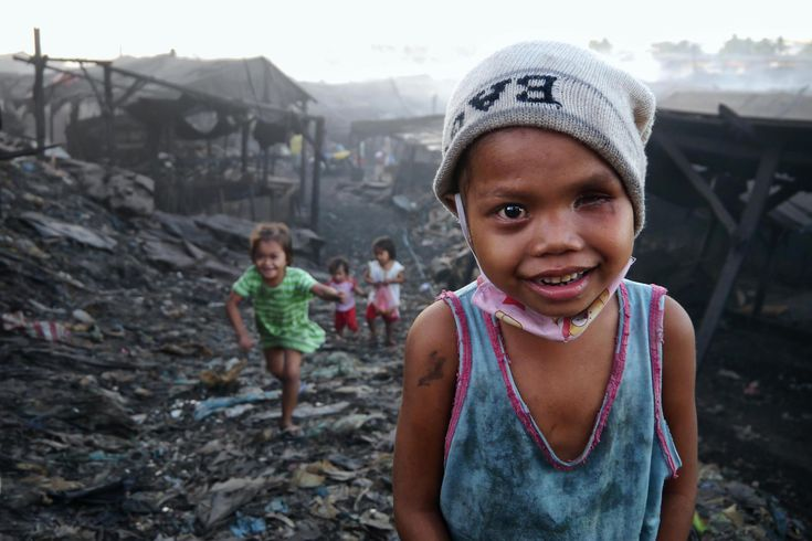 Little Girl Uligan Slums Outside Of Manila Philippines