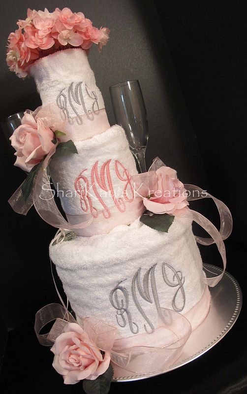 A beautiful and custom created bridal shower towel cake. Monogrammed Wedding Towel Cake by ShariKay's Kreations. www.SharikaysKreations.etsy.com