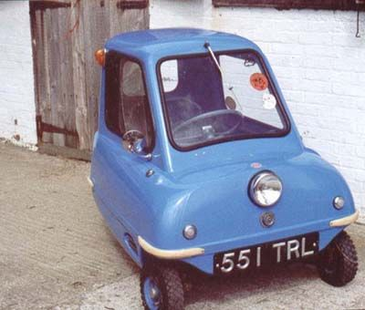 Peel P50: Built by the Peel Engineering Company on the Isle of Man in 1963 with a 49 cc two stroke moped engine, this three wheeled single seater was a real car and intended for road use. It had three forward speeds, reverse being accomplished by lifting the car by its chrome handle in the back and turning it around!