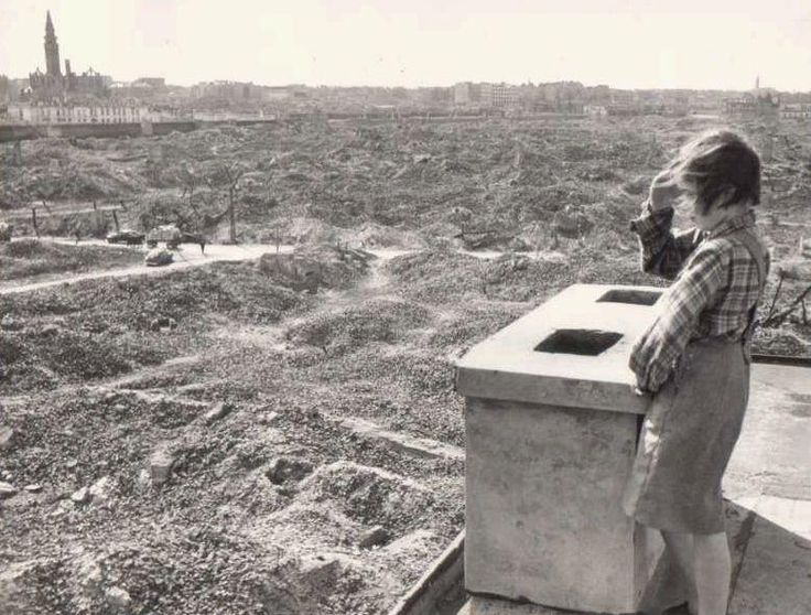 Girl looks out over the ruins of Warsaw, c.1945