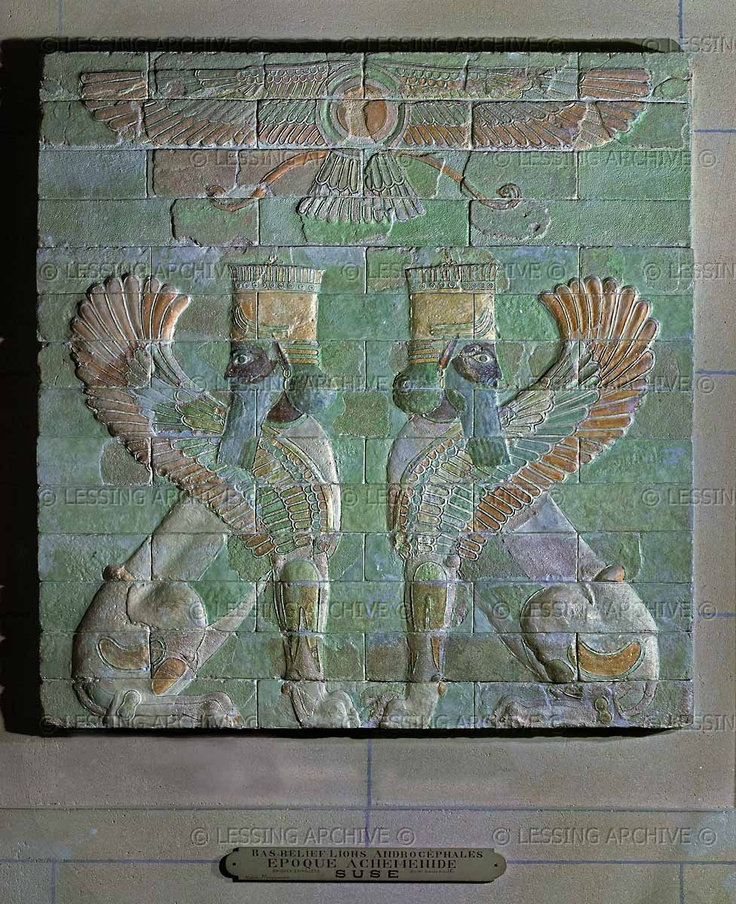 Achaemenid Relief, 6th century BCE. Two winged sphinxes topped by a winged disk, emblem of the god Ahura Mazda. Enamelled brick panel (6th-5th BCE) from Susa, Iran.