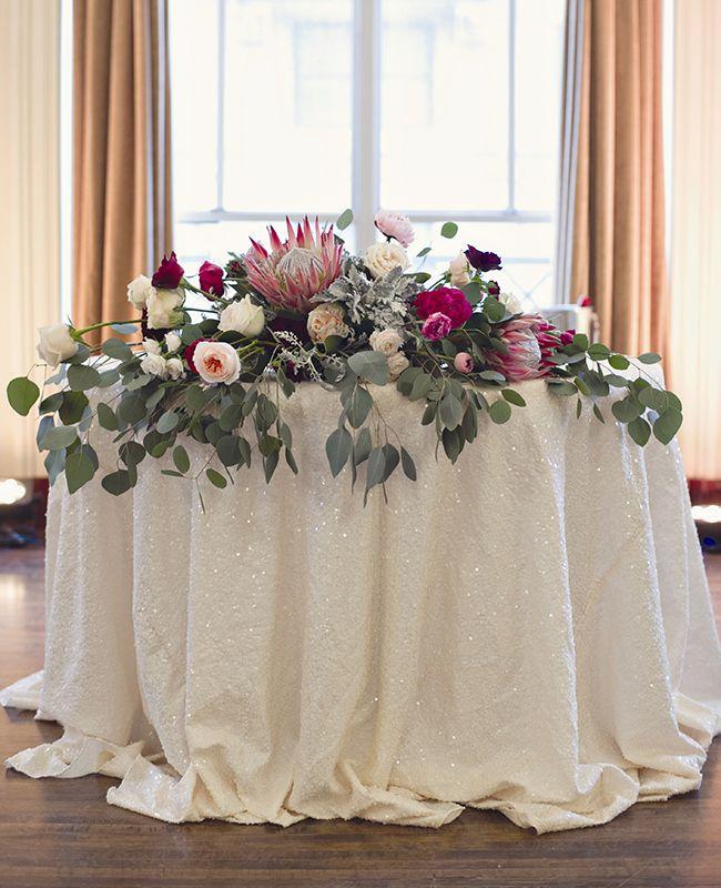 eucalyptus reception table decor | Heather Saunders Photography | Blog.theknot.com