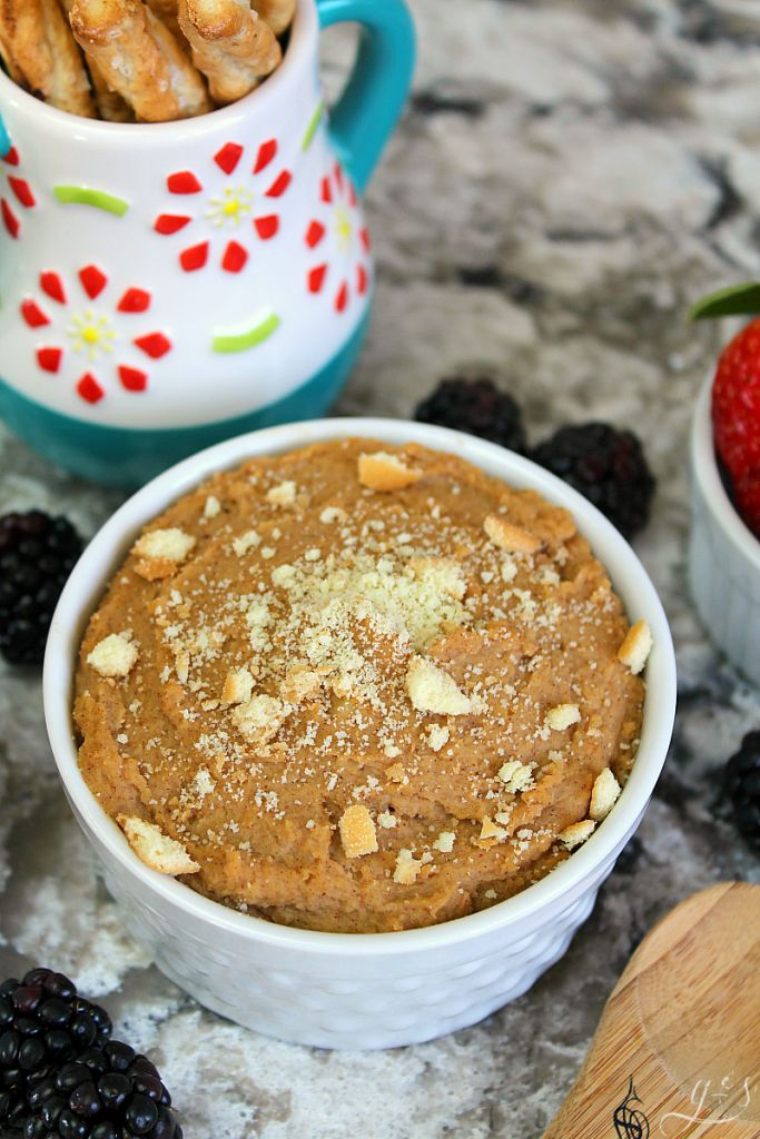 The BEST Snickerdoodle Hummus | This clean eating homemade recipe makes the perfect snack or dessert. Healthy, gluten free, six ingredients- what more could you want?! Chickpeas (garbanzo beans), maple syrup, peanut butter (nut butter), cinnamon, vanilla, salt make the best cookie flavored fruit dip EVER. Dippers to use: berries, apples, Nilla wafers, pretzels! #recipes #snacks #easy