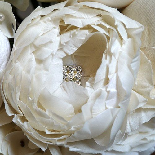 Our Queen of Sweden is a beautiful bloom with incurved petals accentuated with a crystal centre. Hand made Silk Flowers for Bridal and Special Occasions. www.purdyinbloom.com/
