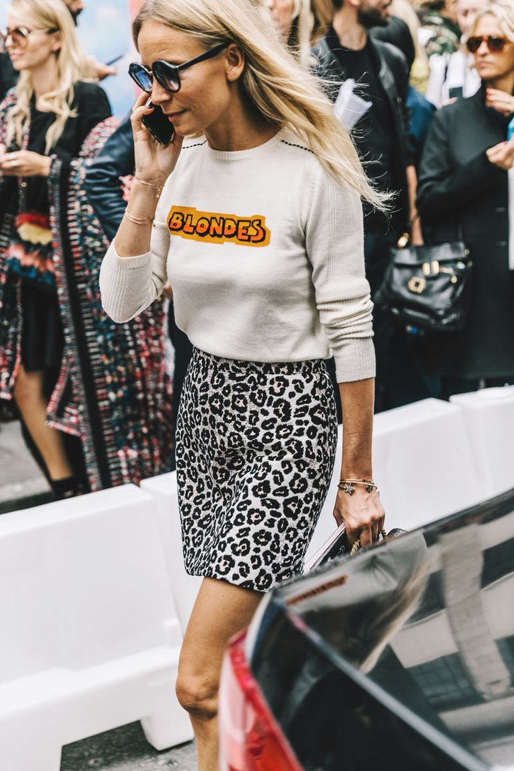 Circle sunglasses, graphic sweater and leopard pencil skirt. | London Fashion Week Street Style