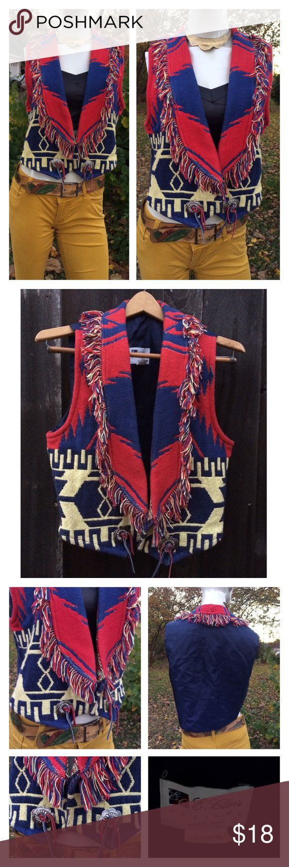 "Vtg Western Cowboy Vest One Size Fringe Tapestry fringe- western tapestry- open front vest w silver conch and leather string embellishments. Measurements are not exact layed flat un-stretched not doubled Shoulder to SHOULDER: 14""  Underarm to underarm: 19.5' Length: 20"" at longest point 18"" at shortest Smoke free home!!!! MADE IN GOOD OL AUSTIN TEXAS U.S.A Thanks!!! Vintage Tops"
