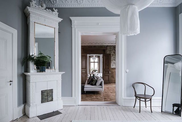 Traditional grandeur meets contemporary in a Swedish space