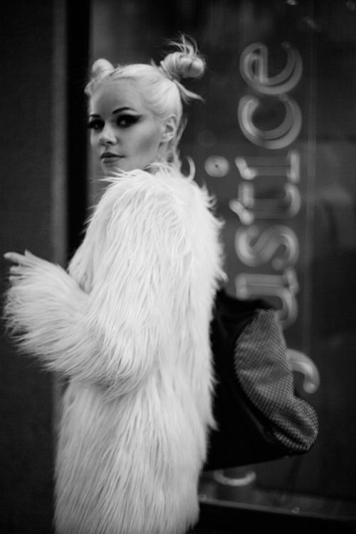 Black eyeshadow,  white faux fur coat,  and blonde hair,  my kind of style, and oh yes, raver buns