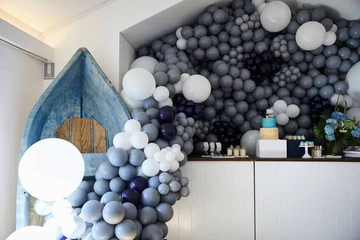 LETTUCE & CO - STYLE. EAT. PLAY - row, row, row, your boat...  nautical themed 1st birthday. grey, white and navy cascading balloon installation. blue vintage rowboat. deserte table.