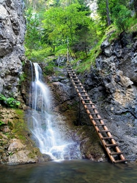 Crystal clear waterfall in Chocsky Hills. This preserved waterfall is located in the Kvacianska Valley, National Nature Reserve, Slovakia.