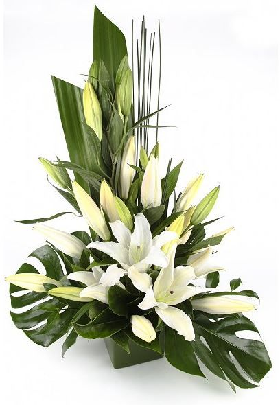 Planter- This incorporates island greenery  as well with the lilies.