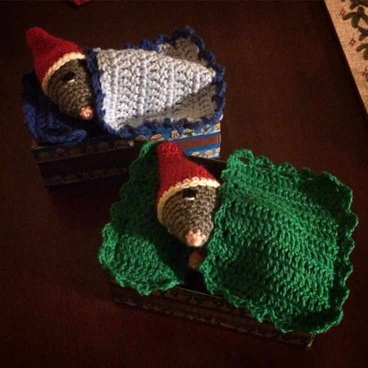 Crocheted mice in their beds.