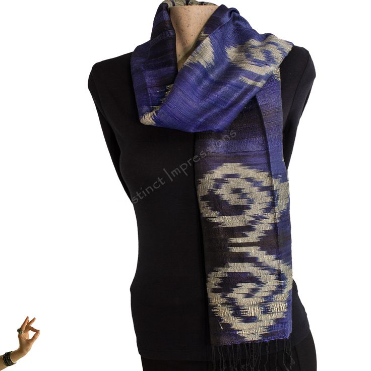 This colourful scarf has been hand made using what is known as a Mudmee Design technique.The scarf itself is a large shawl and ideal for any occassion.