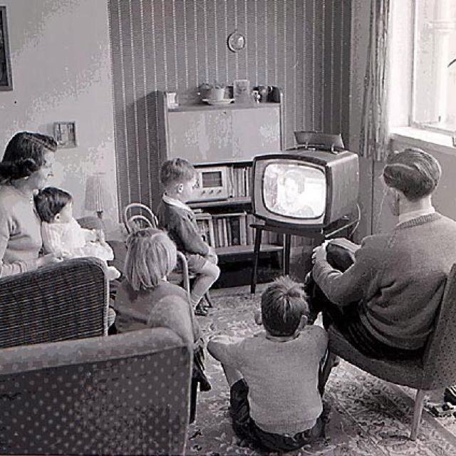 1950s family life around the tube. It was that way for us and we had a radio like the one sitting on the bookshelf too. Memories...memories, memories.