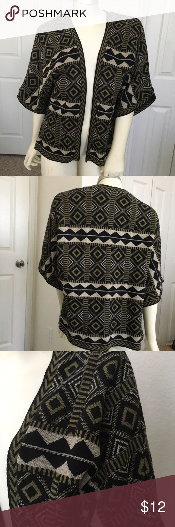 """BEAUTIFUL TRIBAL AZTEC VEST Atmosphere Tribal Aztec vest. Worn just once. Made in Romania. Size medium. Approximately 21""""length from armpit to the armpit. 21""""length from shoulder to the hem. No rips, tears or stain. In excellent condition atmosphare Jackets & Coats Vests"""