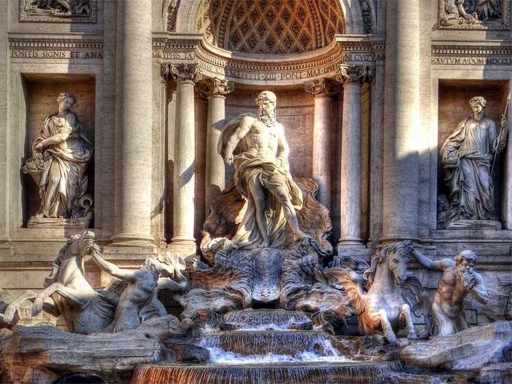Trevi Fountain with Oceanus riding a clam shell chariot, flanked by two Tritons.