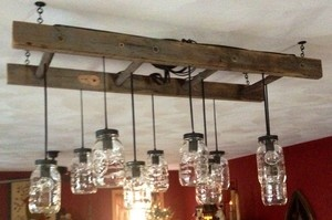 love the ladder as a base for the ball jar chandelier