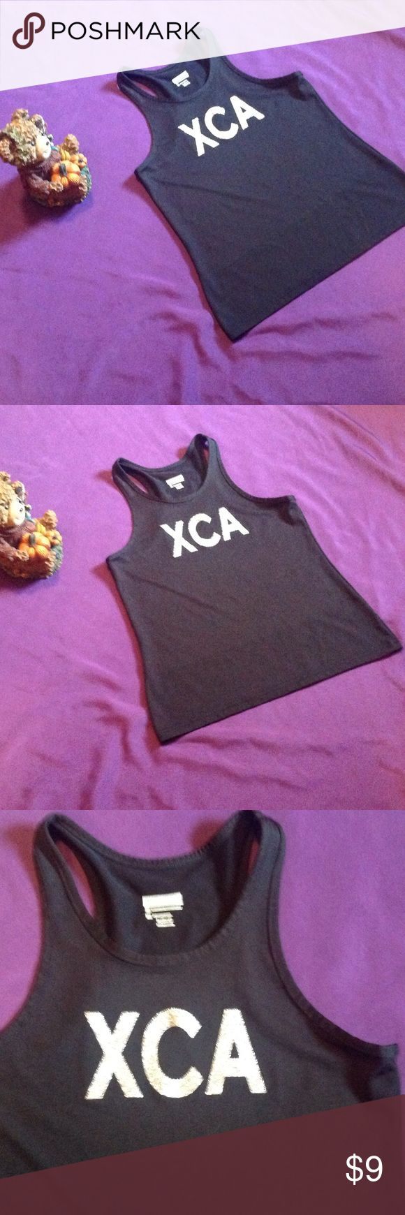 """Augusta black ladies tank top in medium Cut little tank from Augusta Sportswear in black size medium. Measurements are as follows: bust 32"""", length 22 1/2"""". In excellent preowned condition. Tops Tank Tops"""