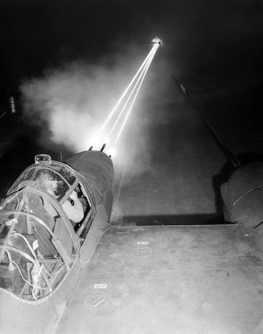 Nose guns of a P-38 Lightning aircraft lighting up the night sky as an armorer test-fired weapons after routine maintenance. #P38Lightning #ww2aircraft