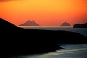 The day closes with a dramatic sunset over the ancient monastic settlements on the Islands of Skellig off Irelands southern coast.